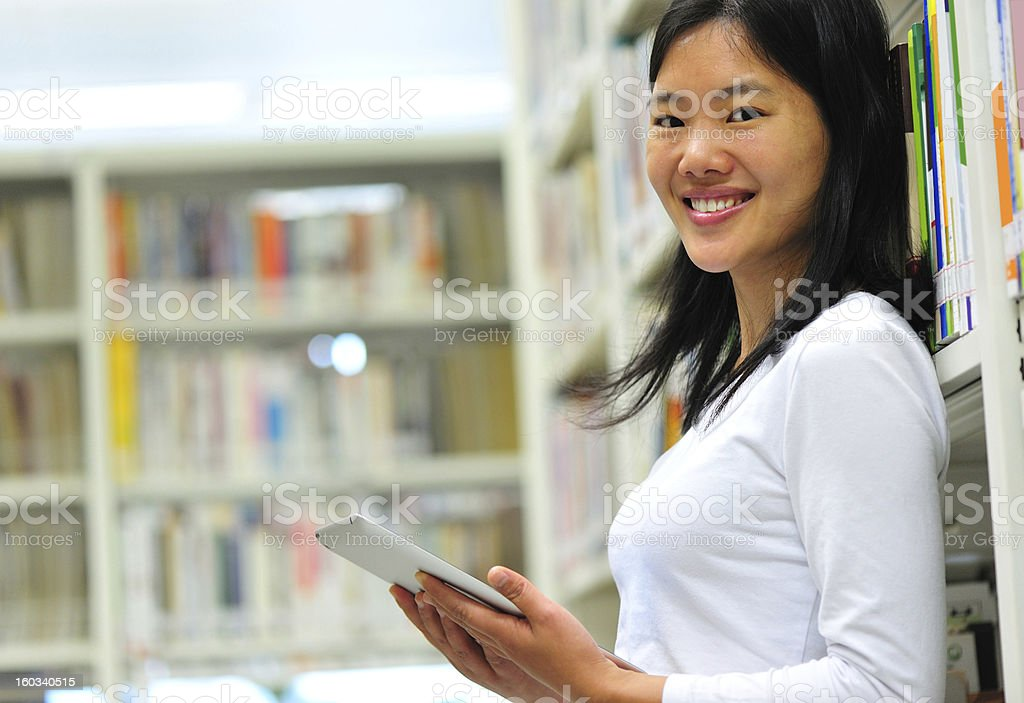 young asian student in library stock photo
