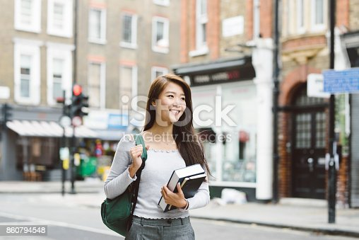 521911045istockphoto Young Asian Student in London 860794548