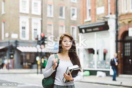 521911045istockphoto Young Asian Student in London 860794576