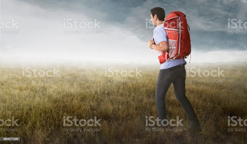 Young asian tourist with backpack going traveling - Royalty-free Adult Stock Photo