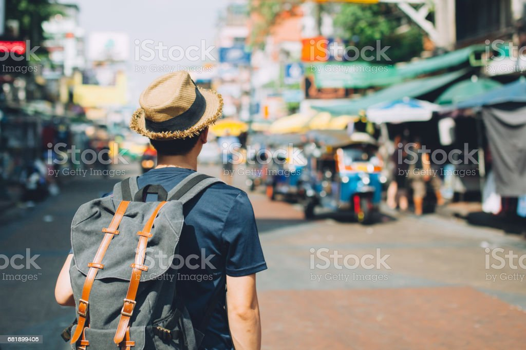 Young Asian traveling backpacker in Khaosan Road outdoor market stock photo