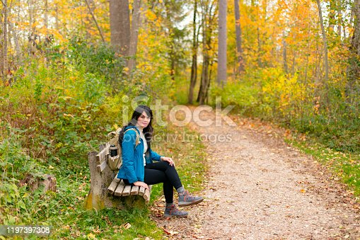 Young asian traveling in fussen forest, Germany
