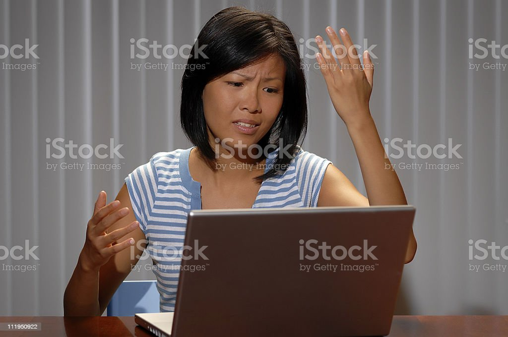 Young Asian University Student Having Computer Problems Virus royalty-free stock photo