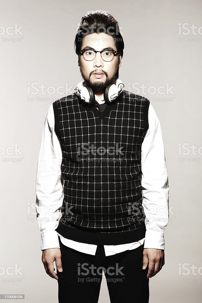 Young Asian wearing sweater and white headphones stock photo