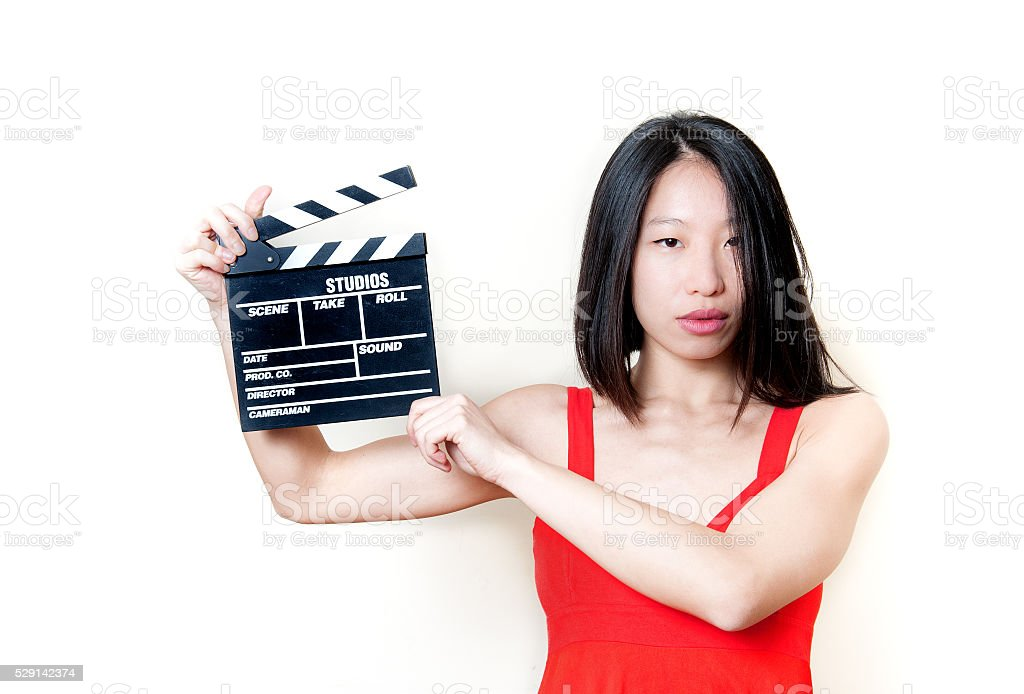 Young asian woman and movie clapper board stock photo