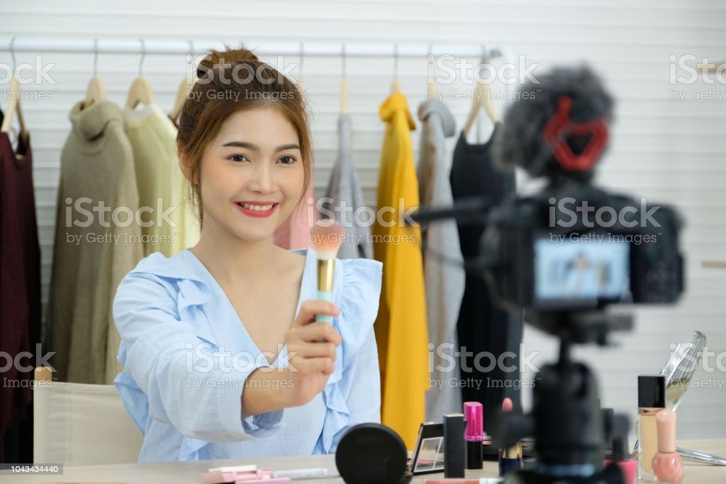 Young Asian Woman Beauty Blogger Showing How To Make Up Video