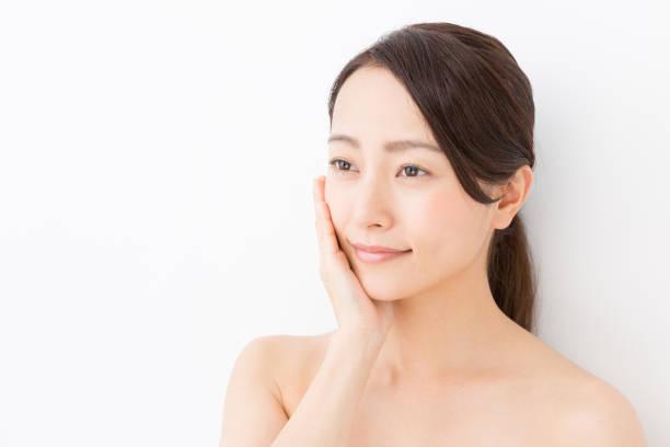 白い背景に分離された若いアジア女性美画像 ストックフォト