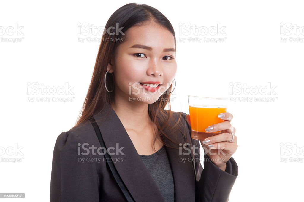 Young Asian woman drink orange juice. royalty-free stock photo
