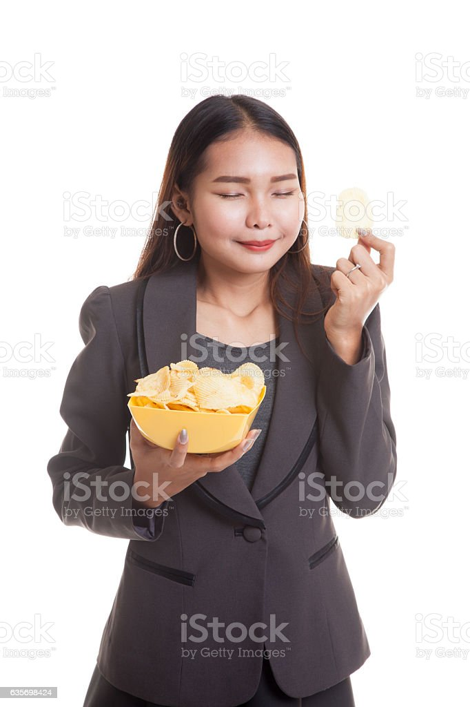 Young Asian woman eat potato chips. royalty-free stock photo
