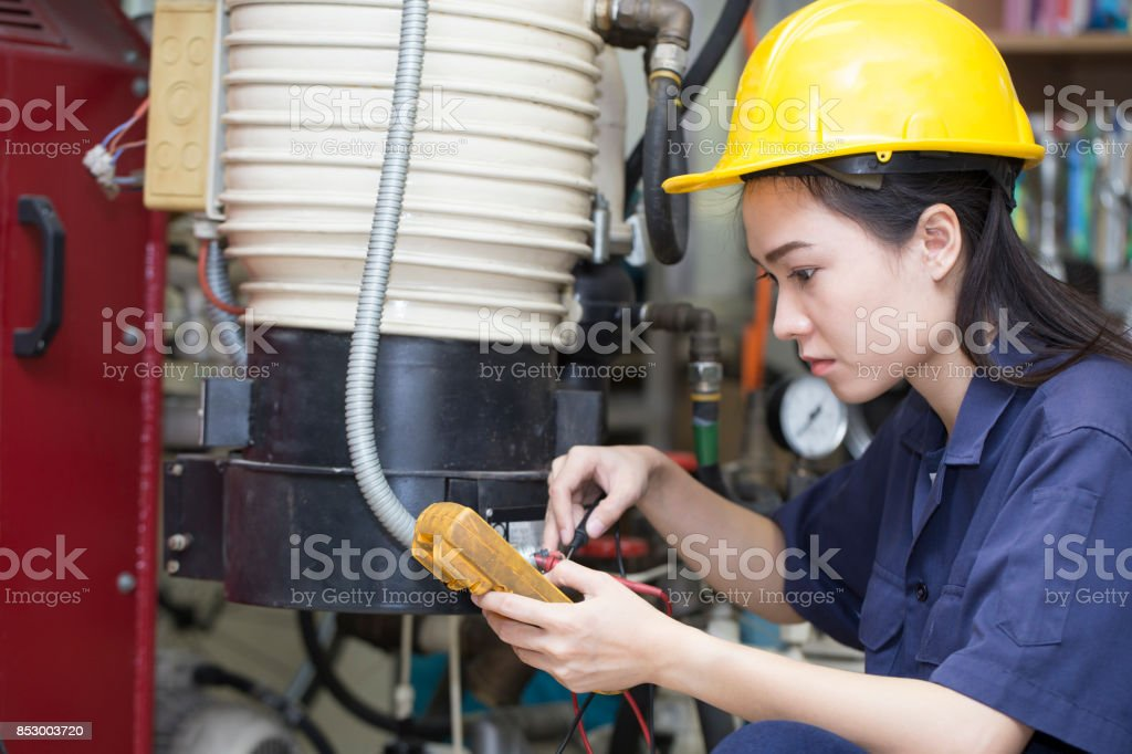 young asian woman engineer set up and testing machine in the laboratory factory, engineering and industrial concept stock photo