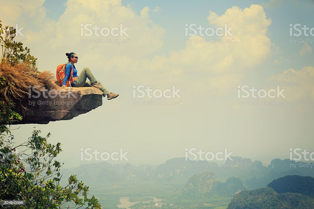 young asian woman enjoy the view at  mountain peak stok fotoğrafı