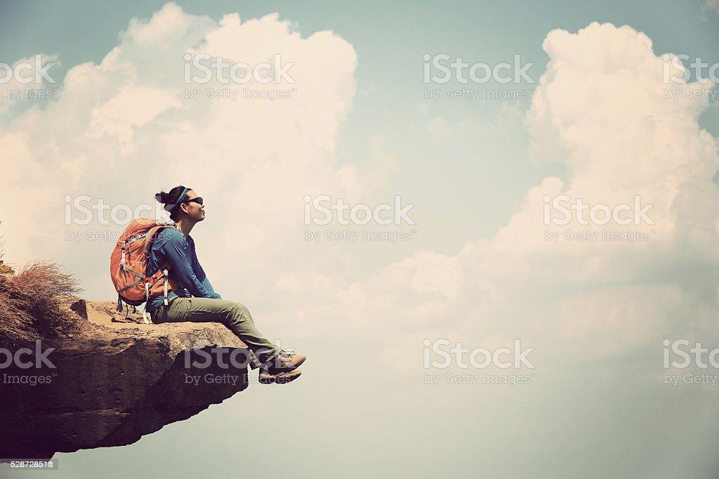young asian woman enjoy the view at mountain peak stock photo