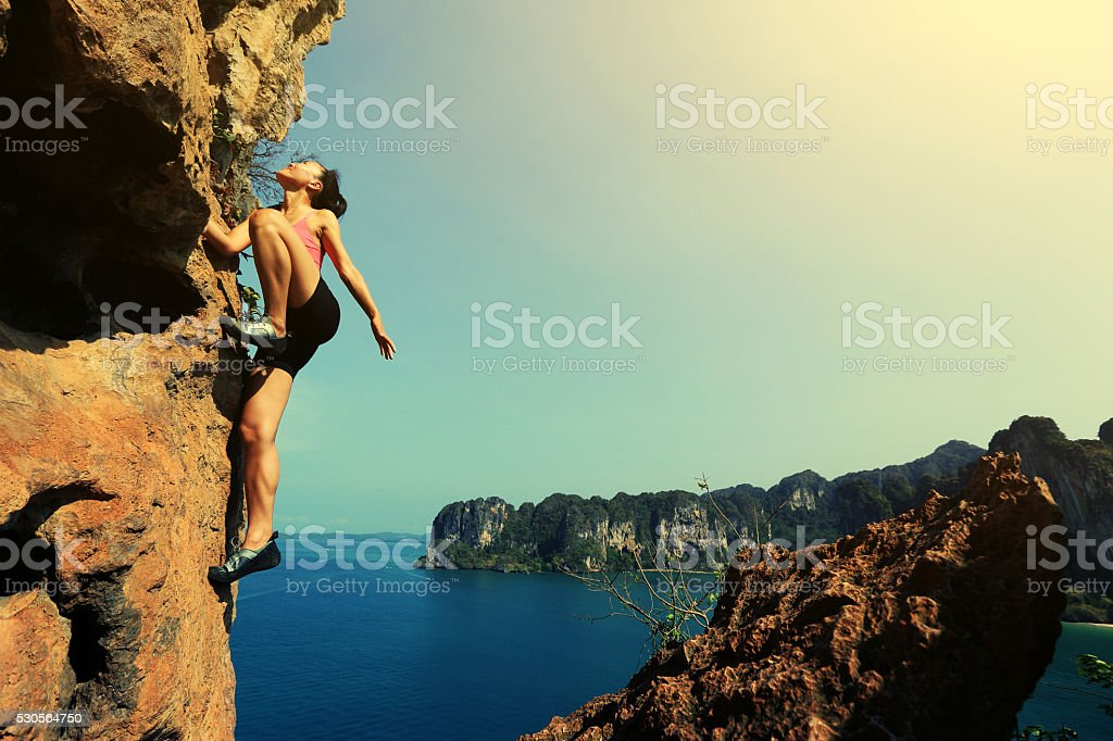 young asian woman enjoy the view at spring mountain peak stock photo