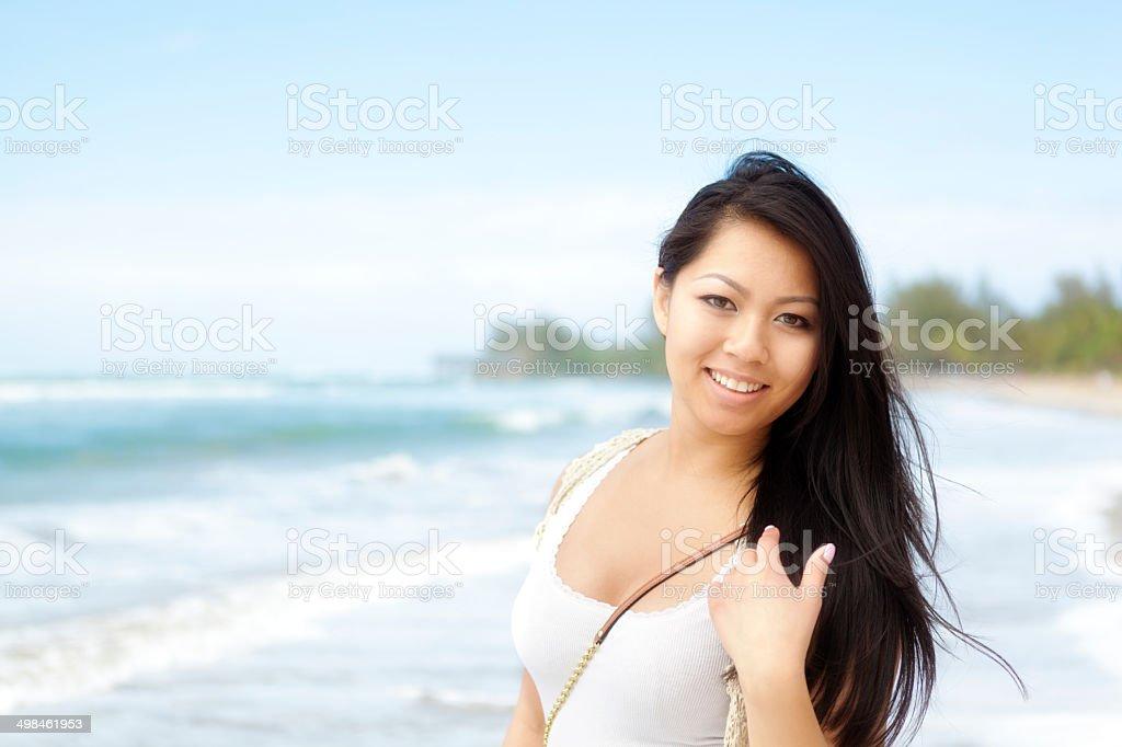 Young Asian Woman Enjoying Vacation on Beach in Kauai, Hawaii stock photo