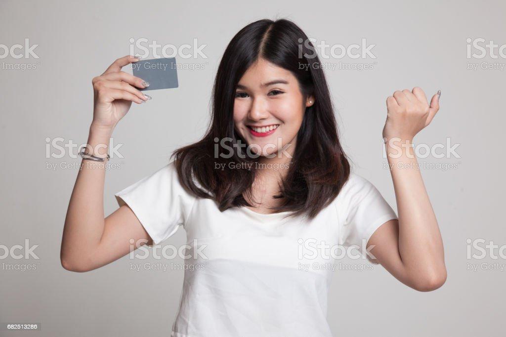 Young Asian woman fist pump with blank card. Стоковые фото Стоковая фотография