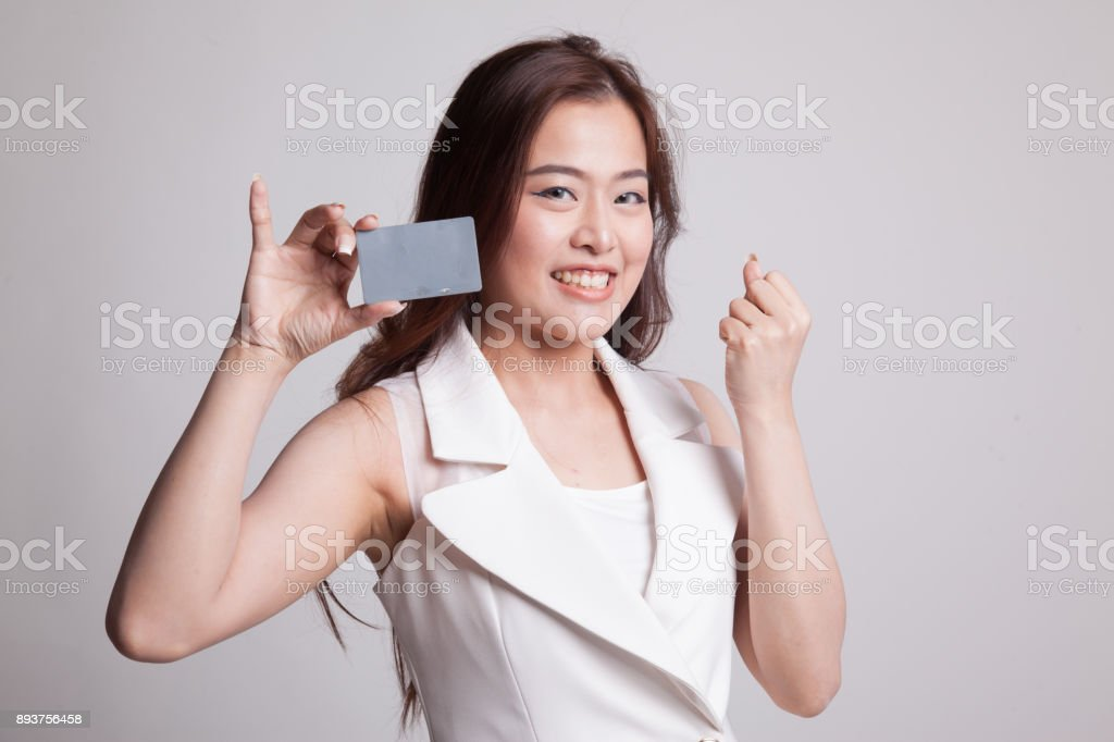 Young Asian woman fist pump with blank card. stock photo