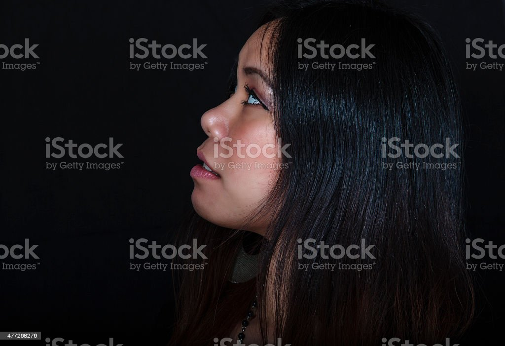 Young Asian Woman Gazing Into the Distance stock photo