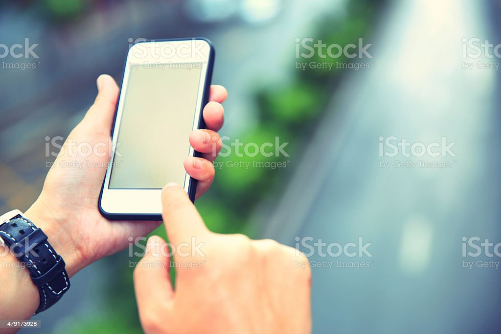 young asian woman hands use smartphone at city young asian woman hands use smartphone at city 2015 Stock Photo