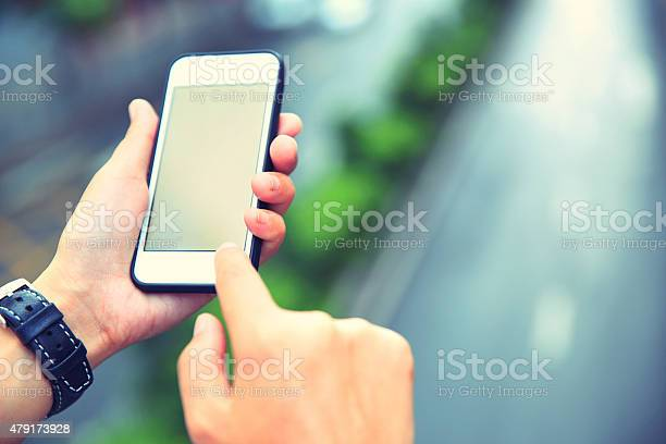 Young Asian Woman Hands Use Smartphone At City Stock Photo - Download Image Now