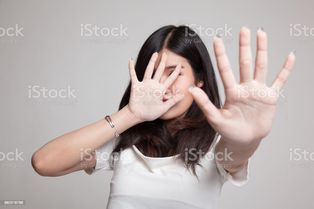 Young Asian woman hide her  face. royalty-free stock photo