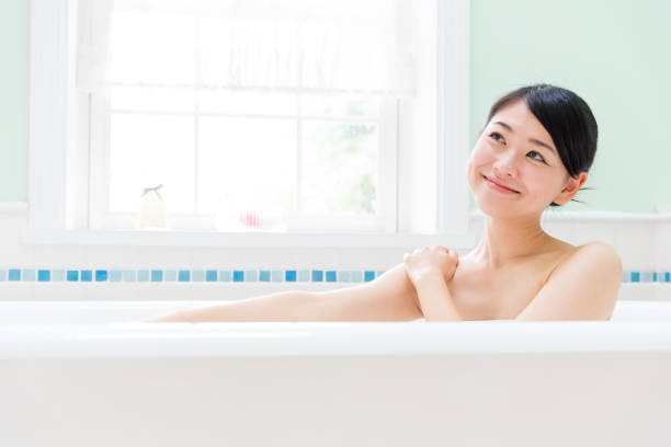 young asian woman in bathroom young asian woman in bathroom taking a bath stock pictures, royalty-free photos & images