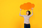istock Young Asian woman in casual clothes with empty speech bubble 1155718397