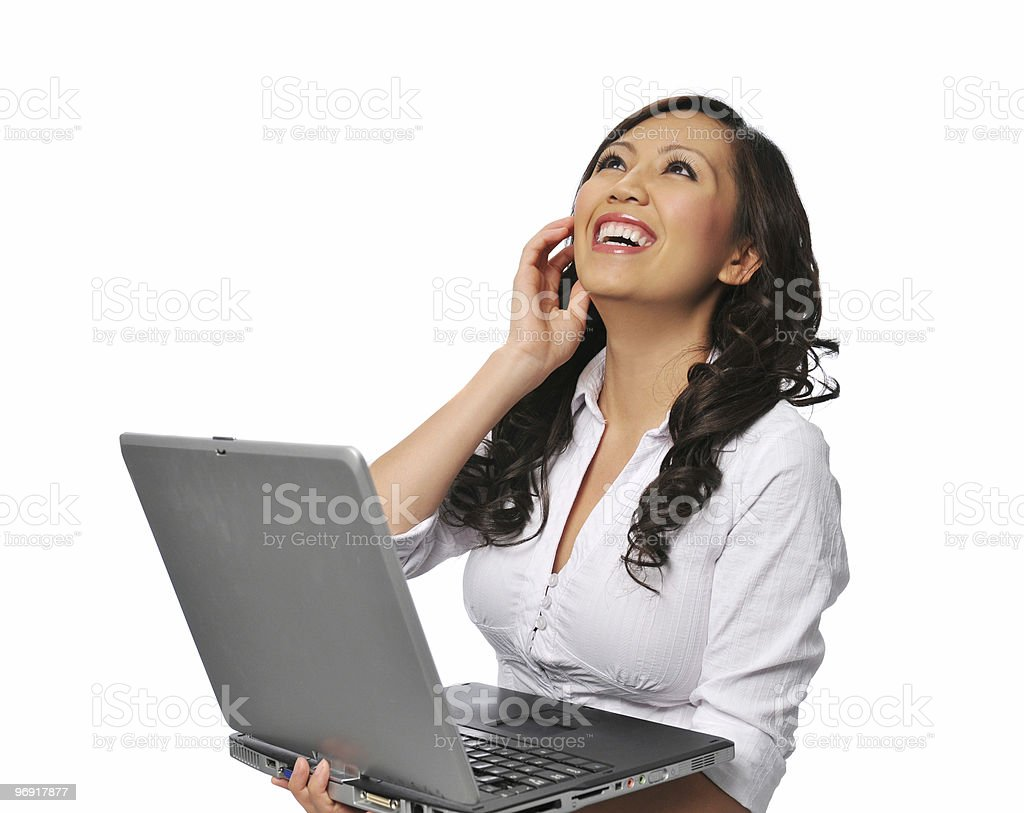 Young asian woman laughing and holding a laptop royalty-free stock photo