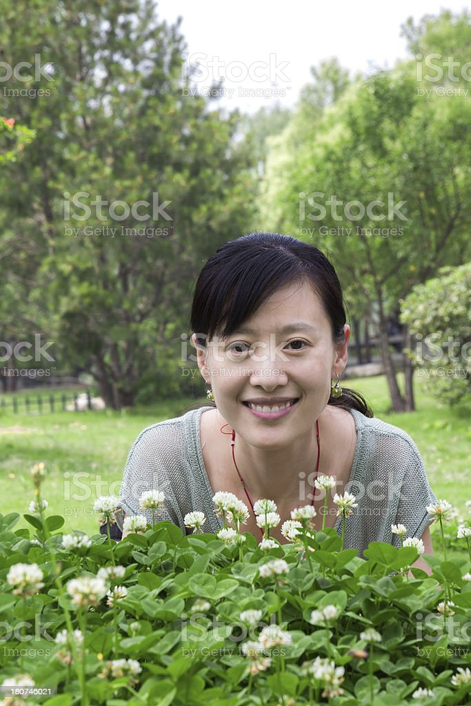 young asian woman lying on grass in nature royalty-free stock photo