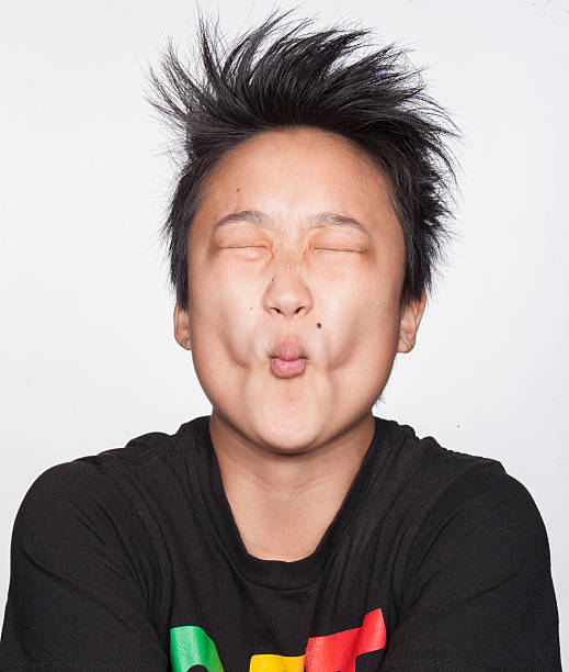 Young asian woman making sour face - Photo