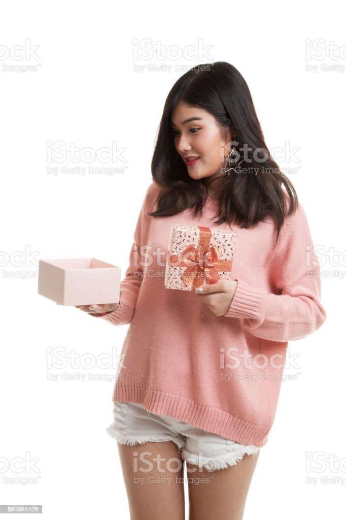 Young Asian woman open a gift box. royalty-free stock photo