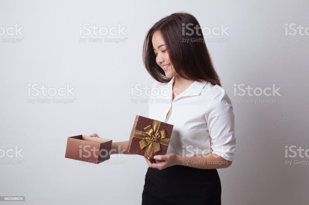 Young Asian woman open a gift box. zbiór zdjęć royalty-free