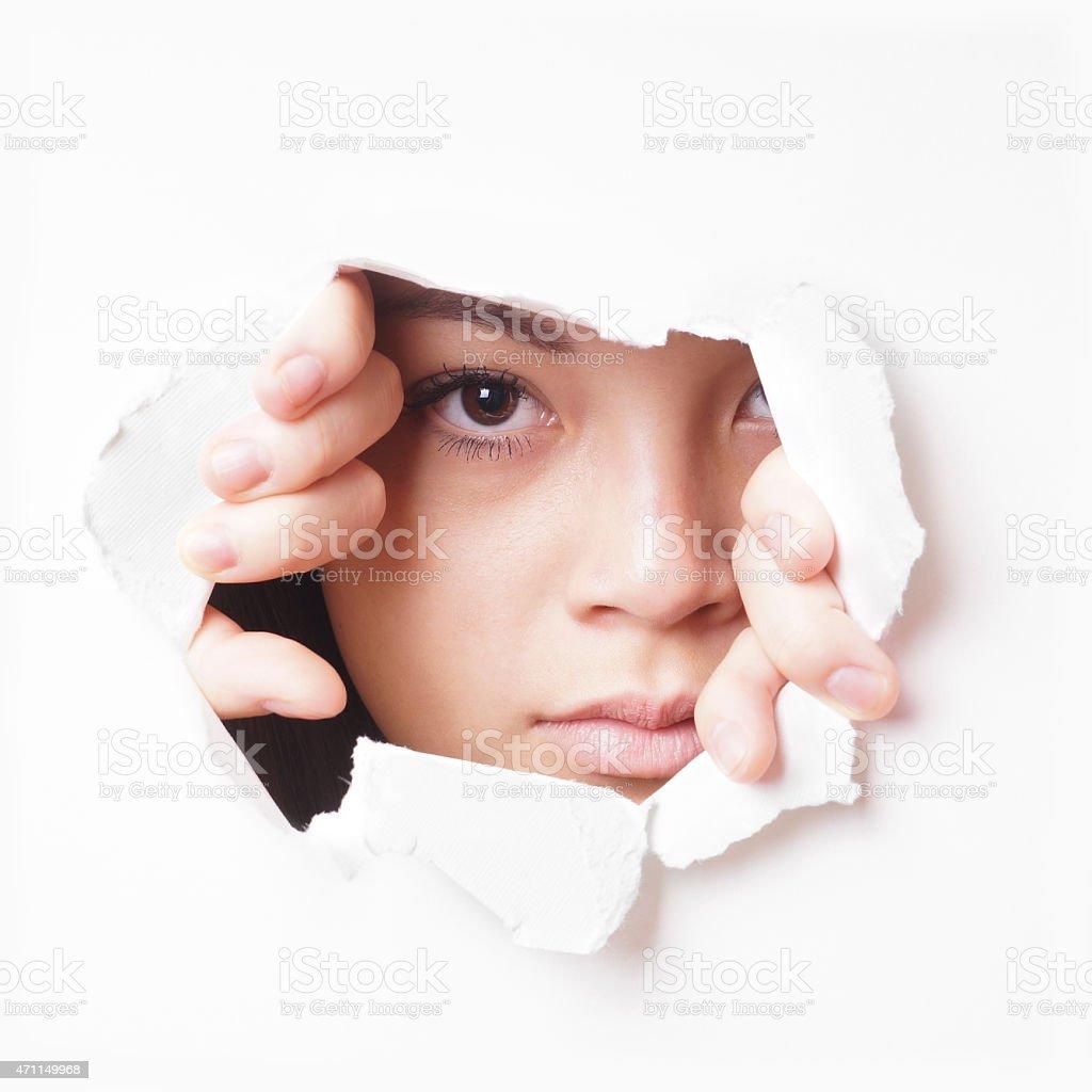 young asian woman peeking stock photo
