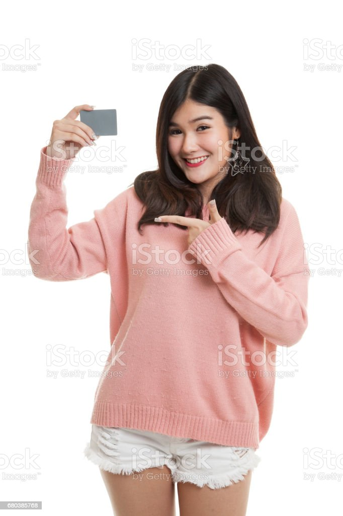 Young Asian woman point to a blank card. royalty-free stock photo