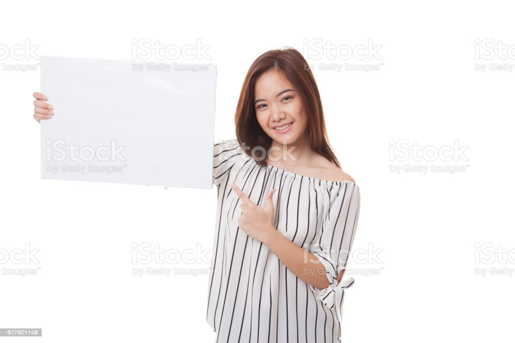 Young Asian woman point to  blank sign. royalty-free stock photo
