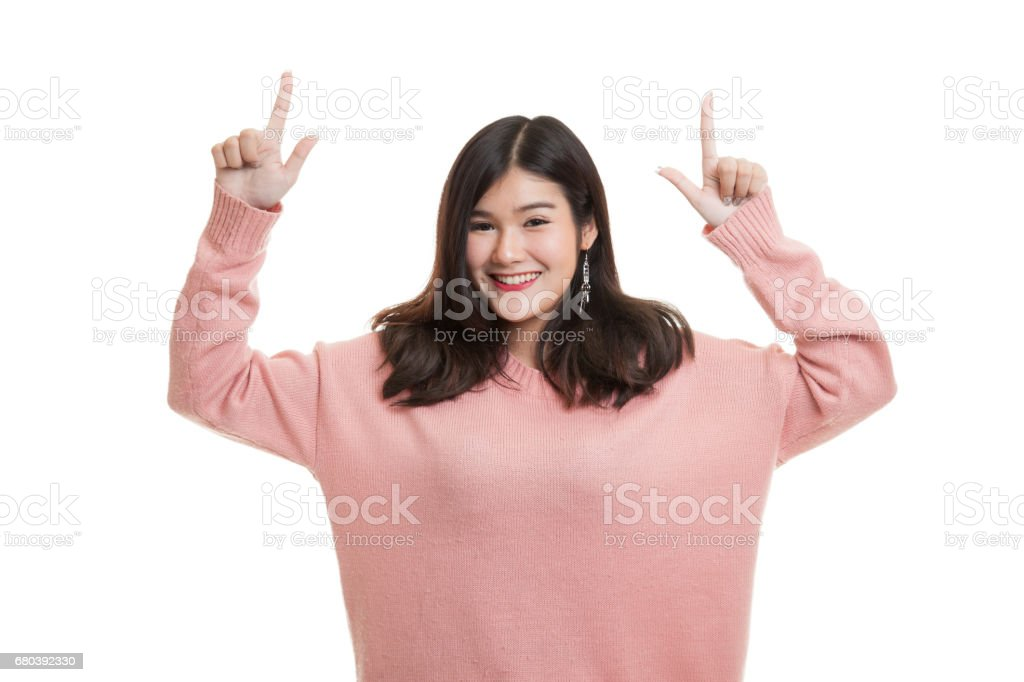 Young Asian woman point to blank space. royalty-free stock photo