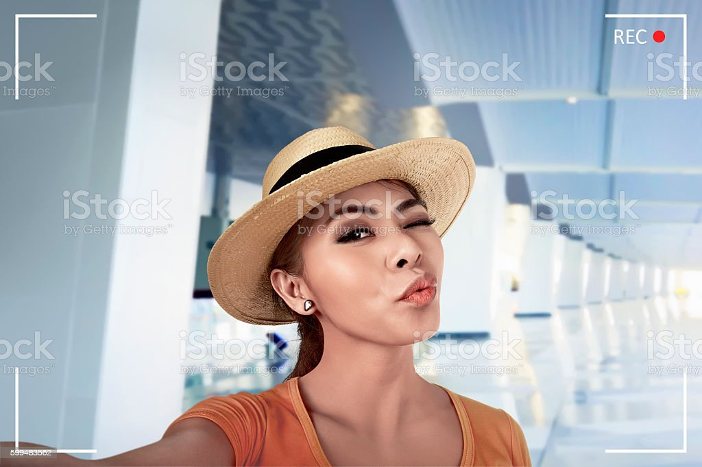 Young asian woman pose selfie in airport lobby stock photo