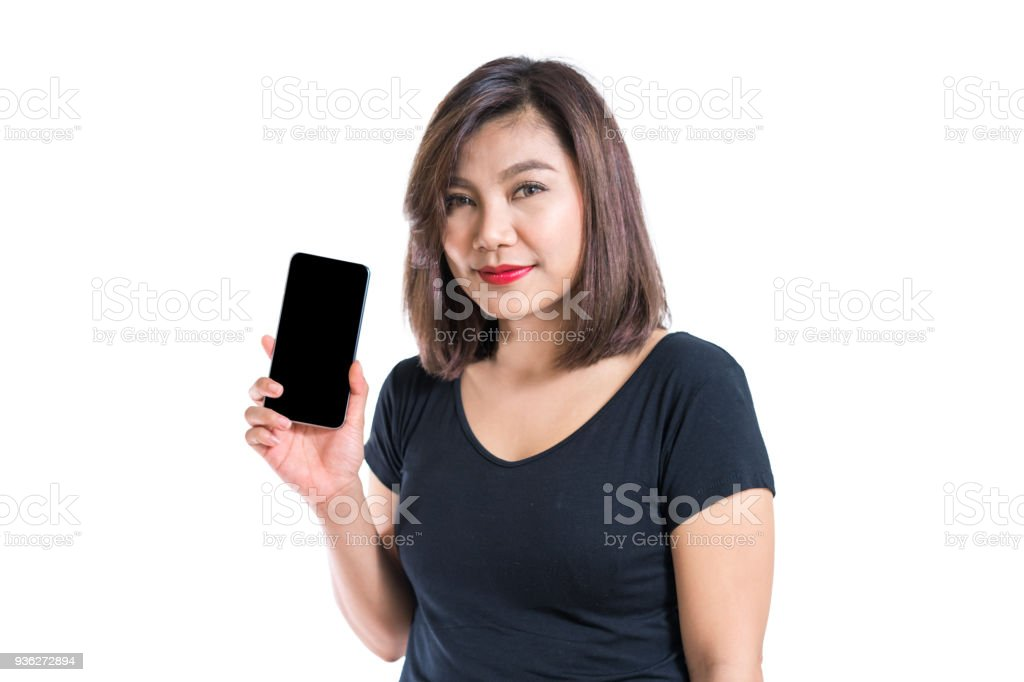 Young asian woman presenting blank scree mobile phone, for application advertisement or commercial promotion, blank shirt, isolated, white background stock photo