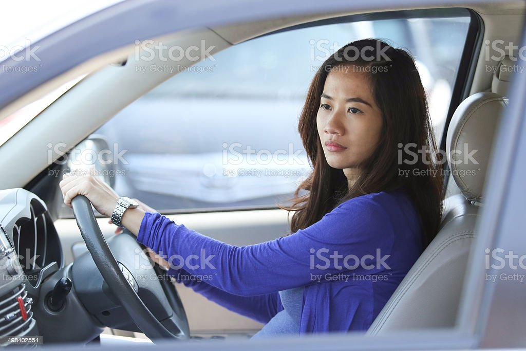 Young Asian woman ride a car, on traffic stock photo