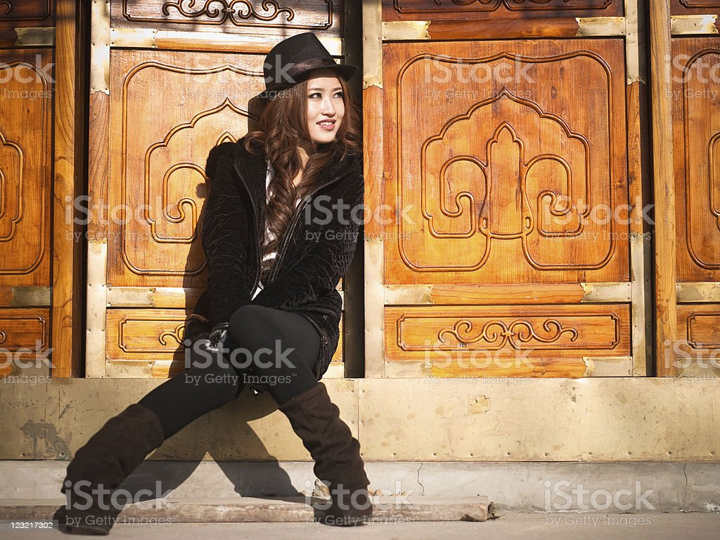 Young asian woman sitting on threshold stock photo