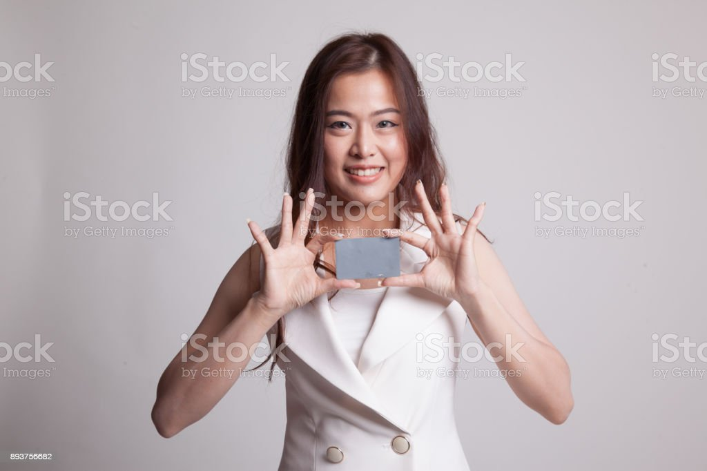 Young Asian woman smile with  blank card. stock photo