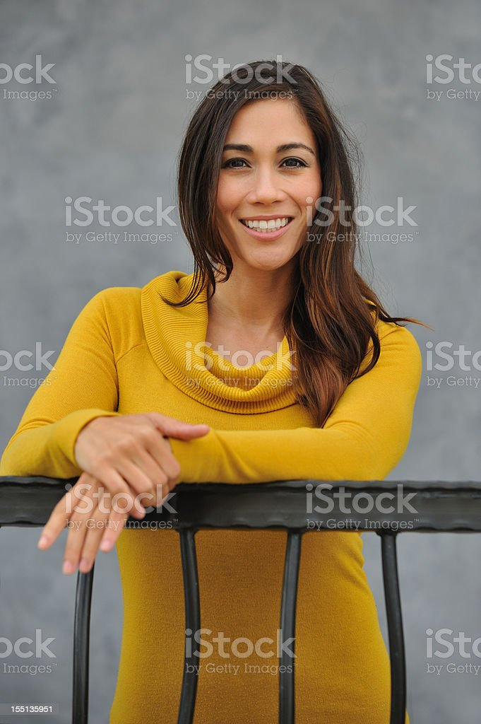 Young Asian woman smiling at the balcony royalty-free stock photo
