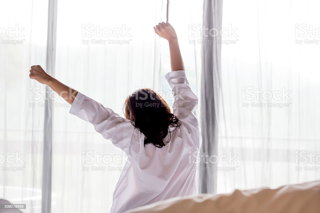 Young asian woman stretching in the morning stock photo