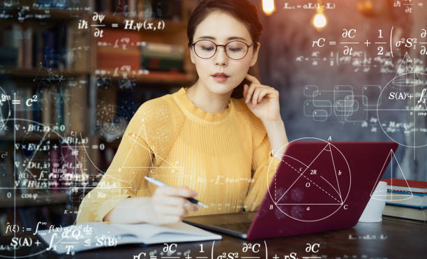 Young asian woman studying in the room. Education concept. Science technology. Mathematics. Young asian woman studying in the room. Education concept. Science technology. Mathematics. mathematical symbol stock pictures, royalty-free photos & images