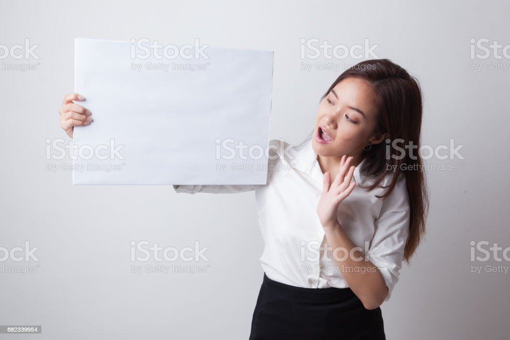 Young Asian woman  surprise with  white blank sign. foto stock royalty-free