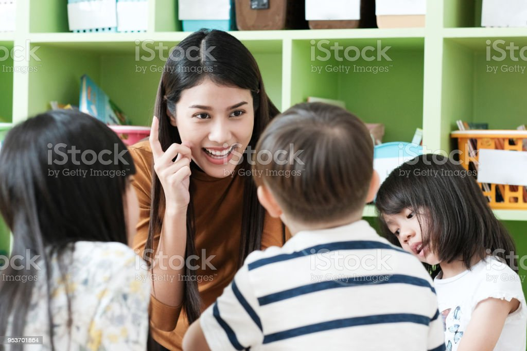 Young Asian Woman Teacher Teaching Kids In Kindergarten Classroom Preschool Education Concept Stock Photo Download Image Now Istock