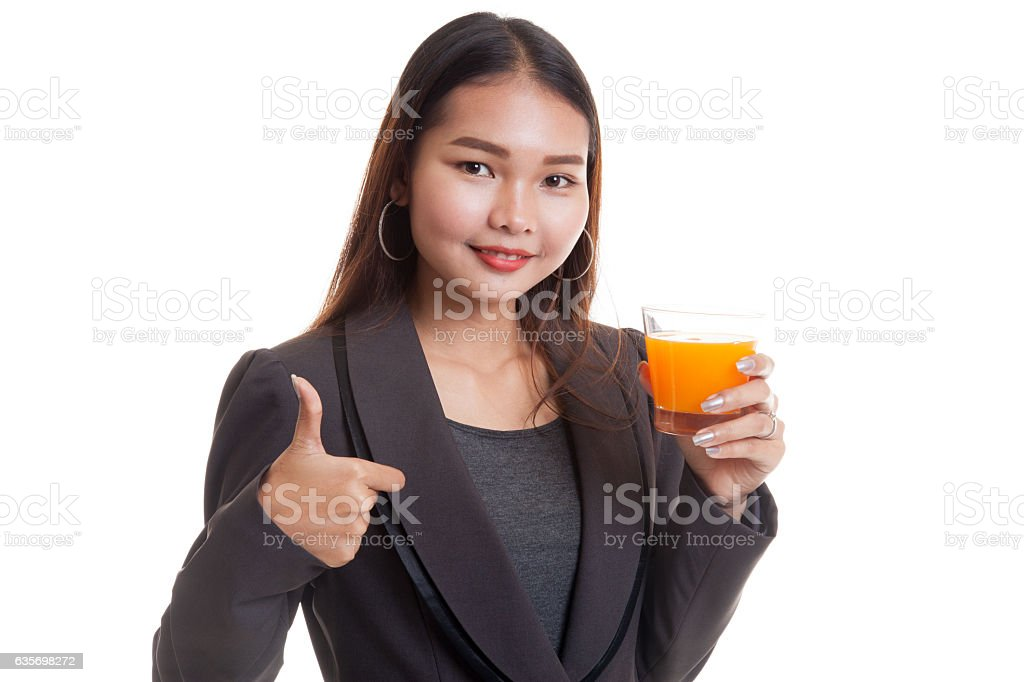Young Asian woman thumbs up drink orange juice. royalty-free stock photo