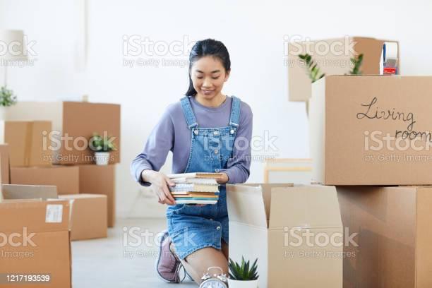Young asian woman unpacking boxes picture id1217193539?b=1&k=6&m=1217193539&s=612x612&h=xvr4hlhfezoq5pz1v2i0lwmnoz1zq7u4dqztflpasxm=