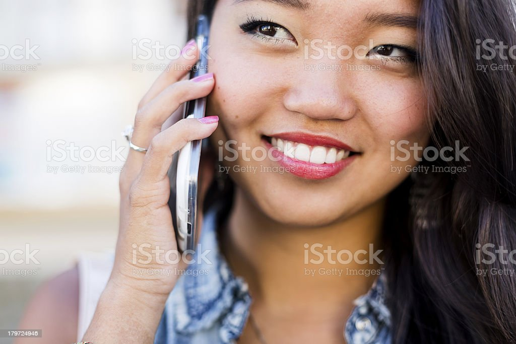 Young asian woman using mobile phone royalty-free stock photo