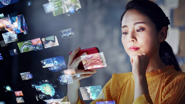Young asian woman watching a lot of movies. Digital transformation. stock photo