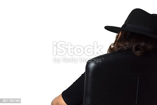 istock Young asian woman wearing a black dress and black hat sitting on the black leather office chair isolate on white background. 901185186